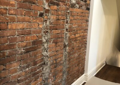 Easton Residence - Existing Historic Brick Wall, Cleaned and Repurposed
